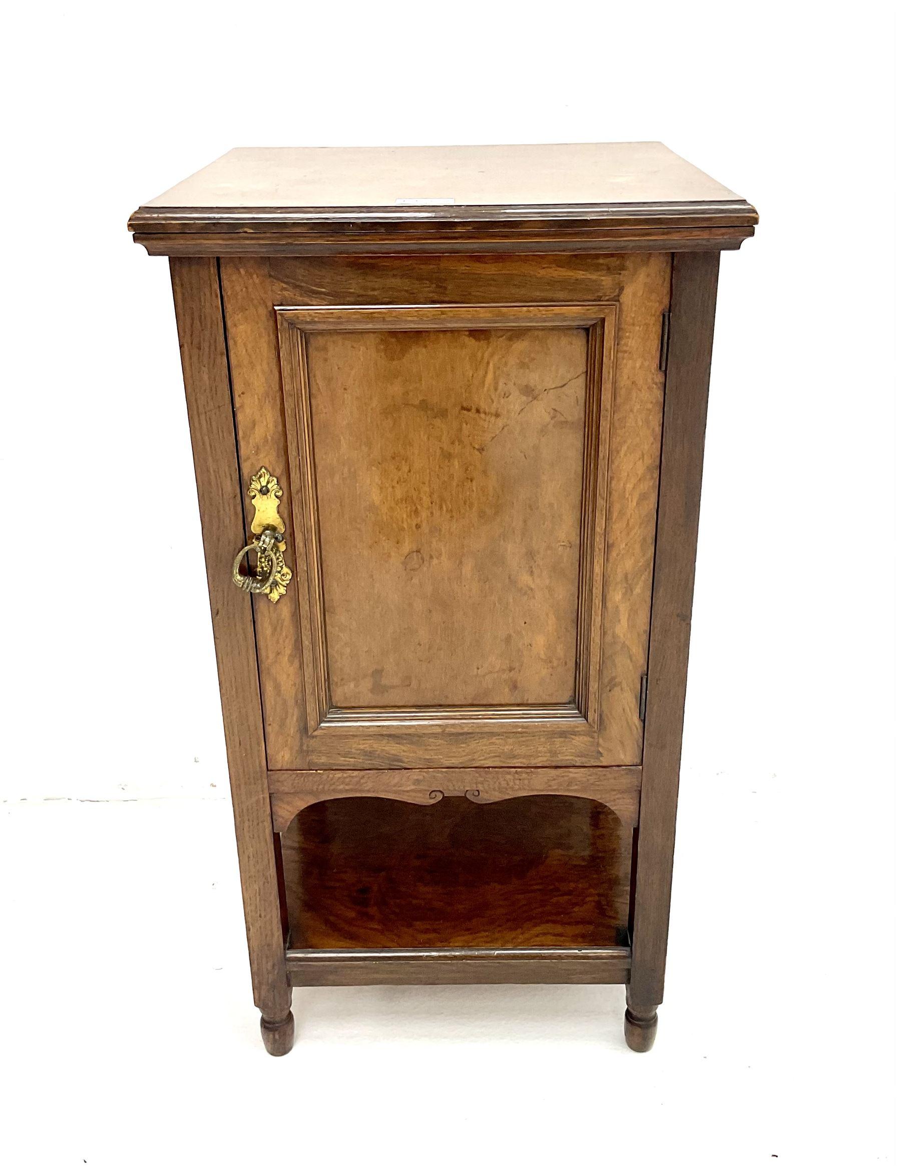 Edwardian oak bedside pot cupboard enclosed by panelled door