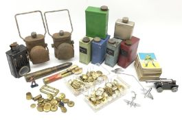 Quantity of Staybrite and other buttons and badges; five oil tins; 1942 20mm brass cartridge case; '