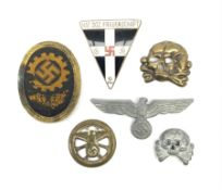 Six WW2 German badges - cap badge D.A.F. labour front; SS skull cap insignia First pattern 1925-35;