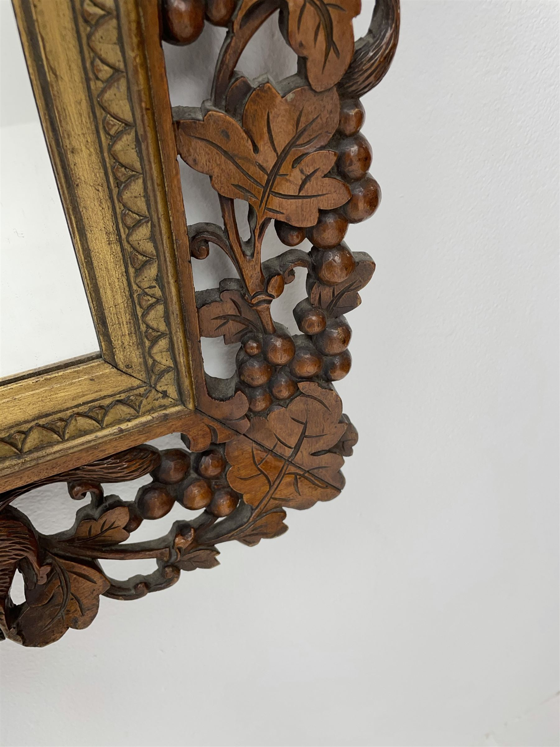 20th century rectangular wall mirror in walnut frame carved and pierced with foliage and berry decor - Image 4 of 4