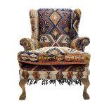 Late 20th century beech framed wingback armchair