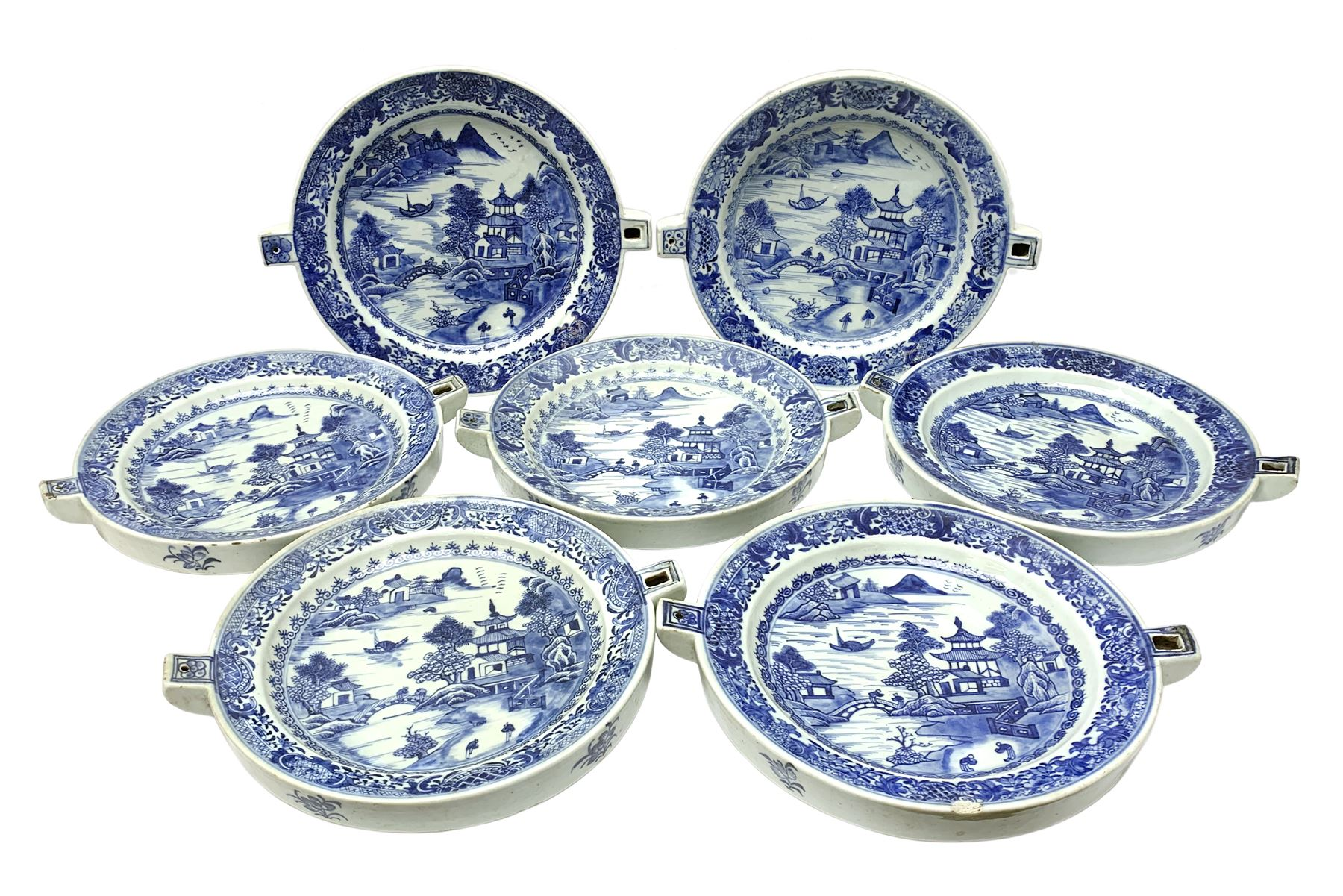 Set of seven late 18th/early 19th century Chinese export blue and white hot water plates