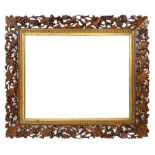 20th century rectangular wall mirror in walnut frame carved and pierced with foliage and berry decor