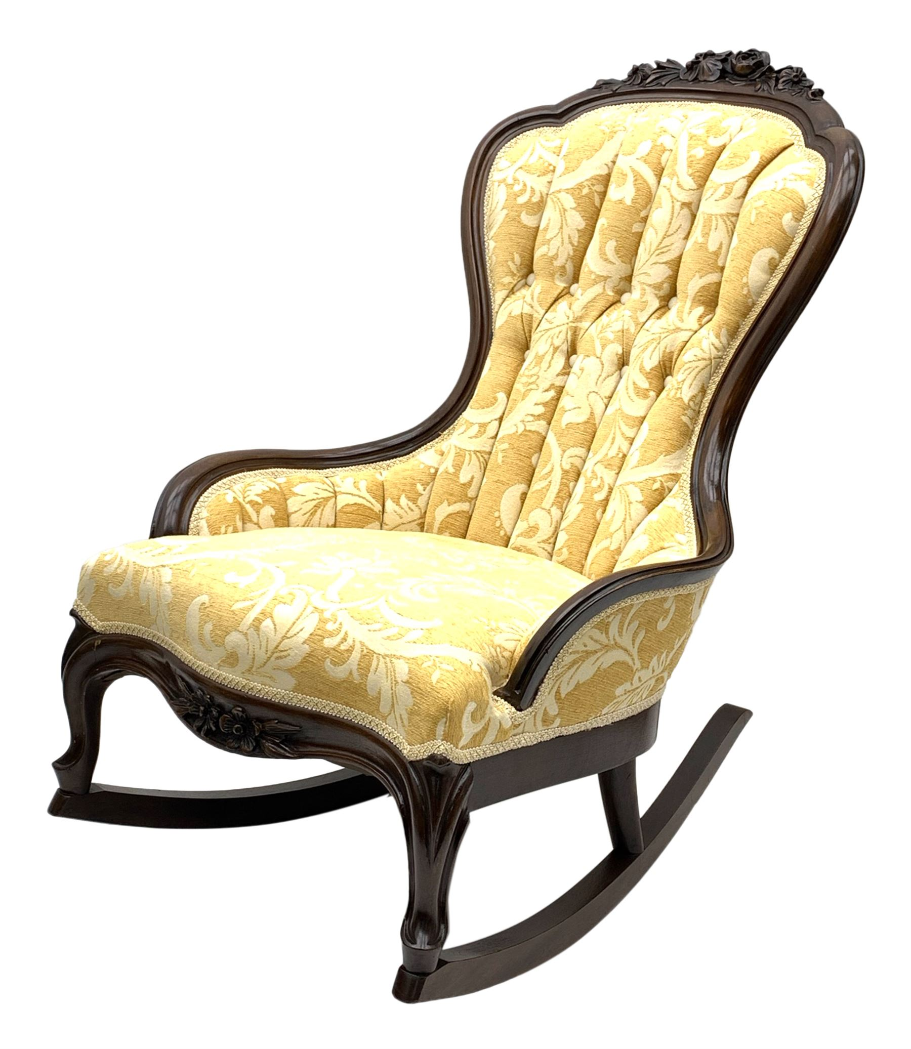 Early 20th century rocking chair with raised floral and foliate carving to frame