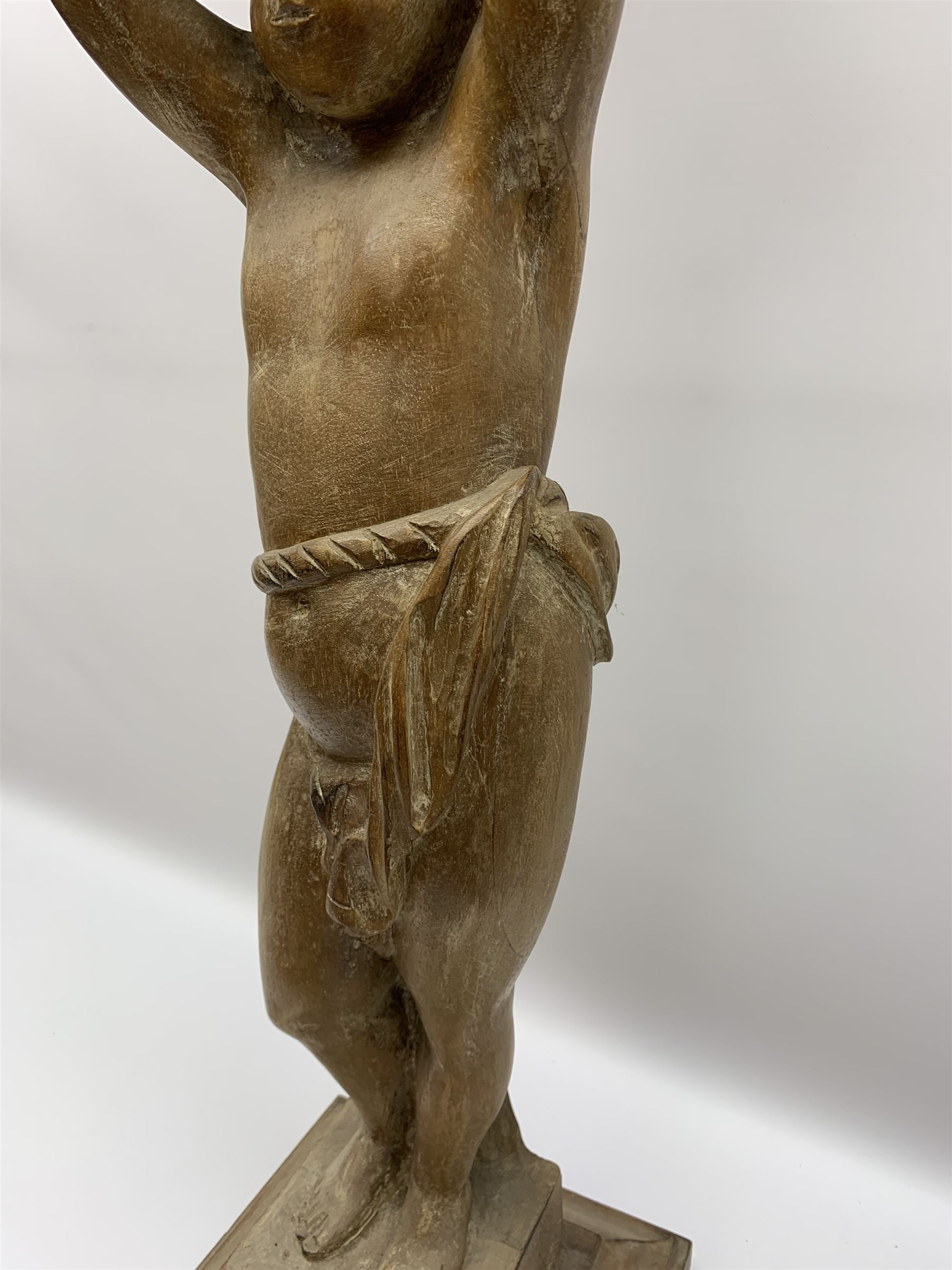 Italian carved lime wood torchère, the column modelled as a putto with arms raised supporting a - Image 6 of 9