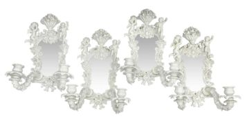 Set of four late 19th/early 20th century Continental girandole white glazed wall sconces