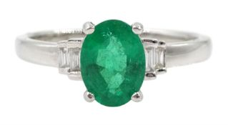 18ct white gold oval emerald and four stone baguette diamond ring