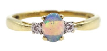 9ct gold three stone oval opal and diamond ring