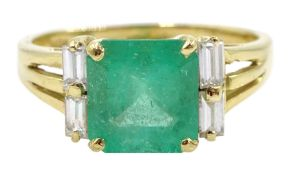 Gold square cut emerald four baguette cut diamond ring