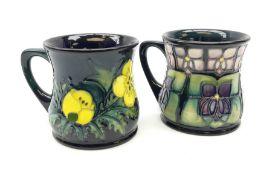 Two Moorcroft mugs of waisted form