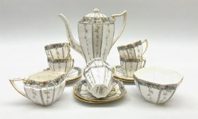 An Art Deco Shelley Queen Anne shape coffee set for six decorated in the Fruit Border pattern