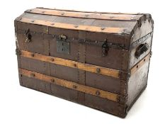 Early 20th century wood and metal bound trunk with dome hinged top