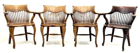 Set eight early 20th century oak captains chairs
