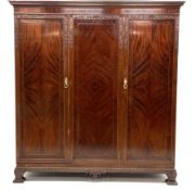 Early 20th century mahogany seven piece bedroom suite - triple wardrobe with projecting cornice of f