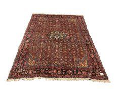 Persian Sarouk red ground rug