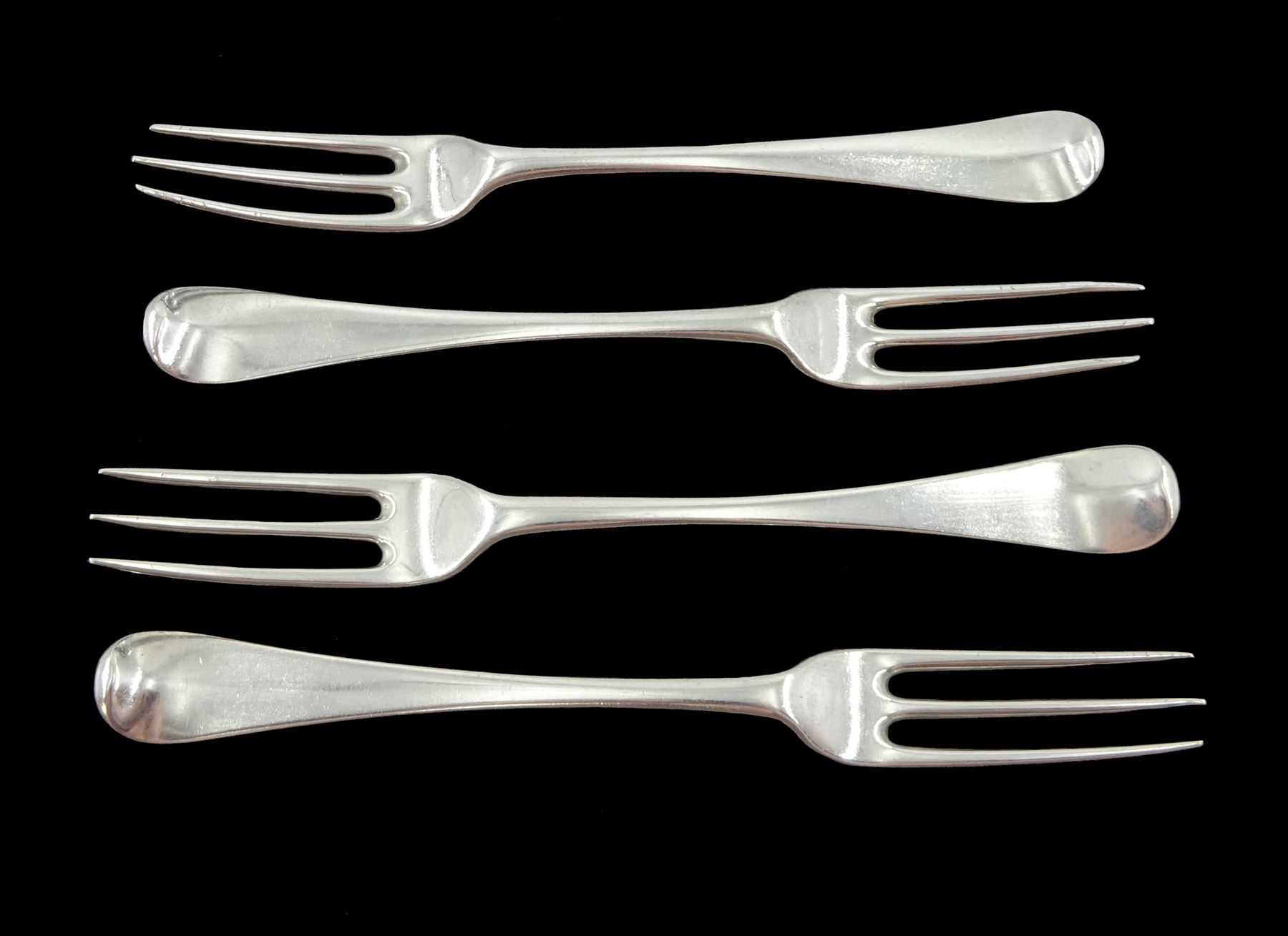 Set of three George II silver three prong table forks