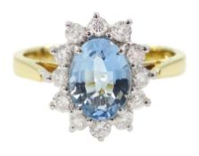 18ct gold oval aquamarine and round brilliant cut diamond cluster ring