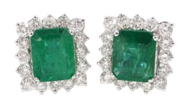 Pair of 18ct white gold emerald and round brilliant cut diamond cluster stud earrings