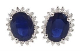 Pair of 14ct white gold oval sapphire and round brilliant cut diamond stud earrings
