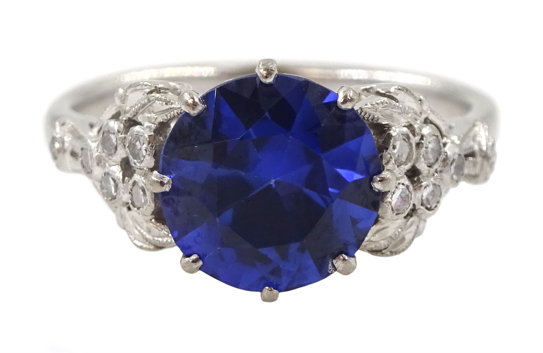 White gold round synthetic sapphire and diamond ring