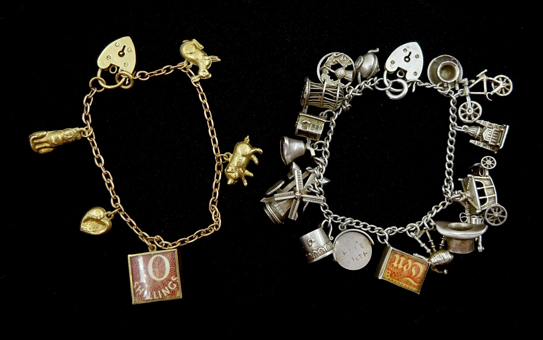 Gold link bracelet with five charms including money box
