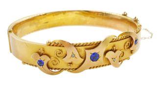 Edwardian 9ct gold blue stone and diamond chip hinged bangle