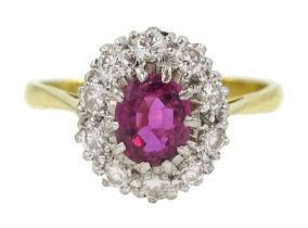Gold oval ruby and diamond cluster ring