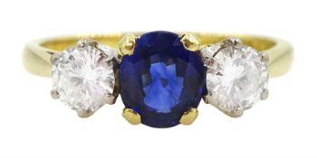 18ct gold three stone oval sapphire and round brilliant cut diamond ring