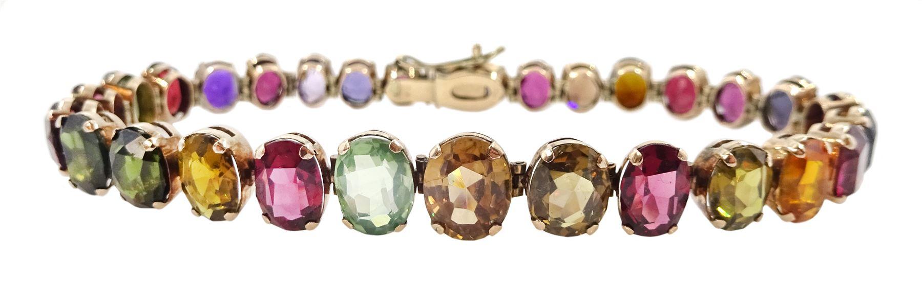 Early 20th century gold graduating oval multi stone set bracelet