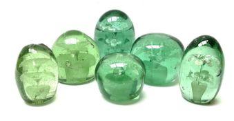 Six Victorian green glass dump paperweights