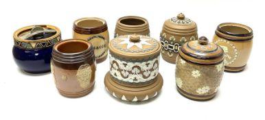 A group of Doulton Lambeth and Royal Doulton tobacco jars