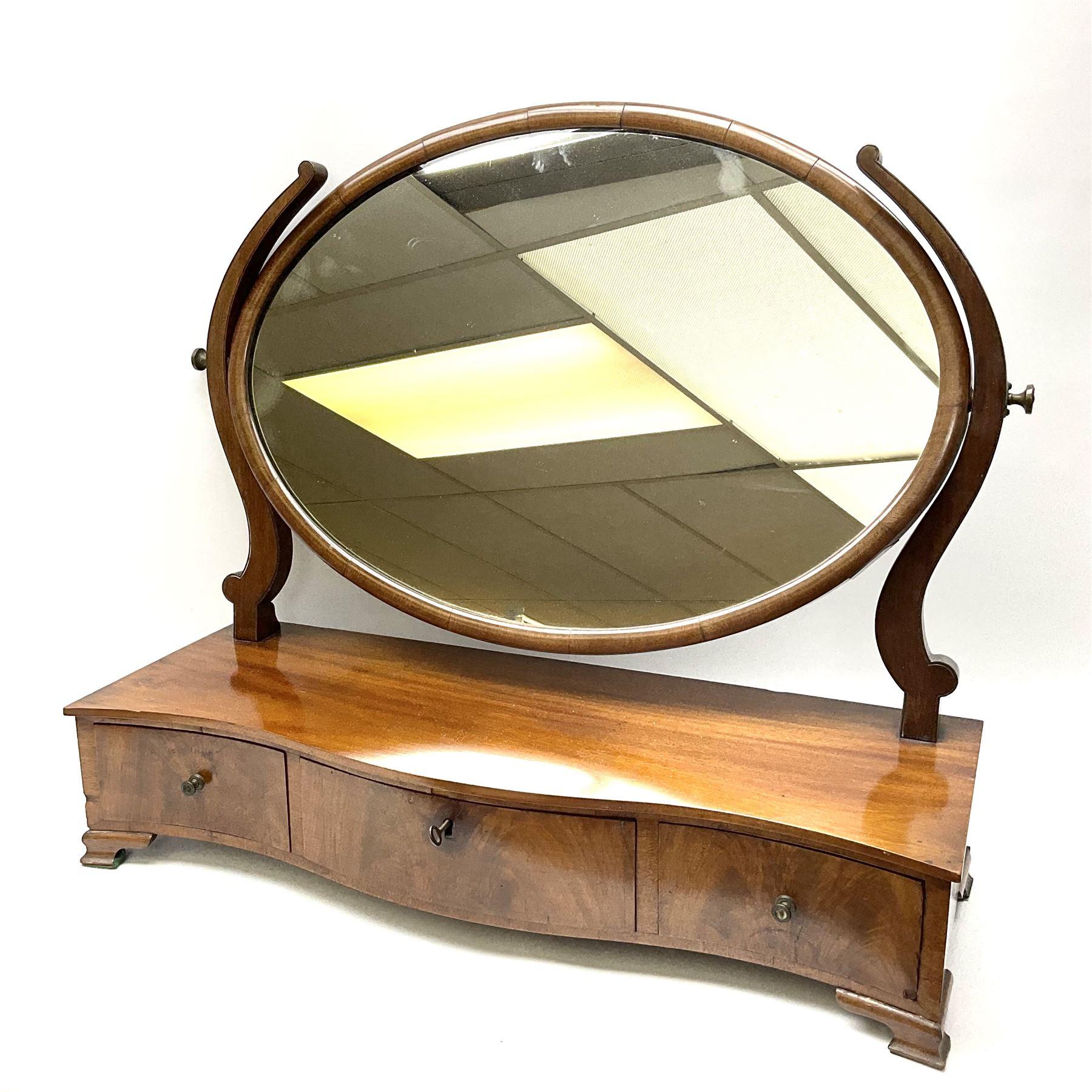 An early 20th century figured mahogany toilet mirror