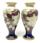 A pair of early 20th century Royal Doulton stoneware vases