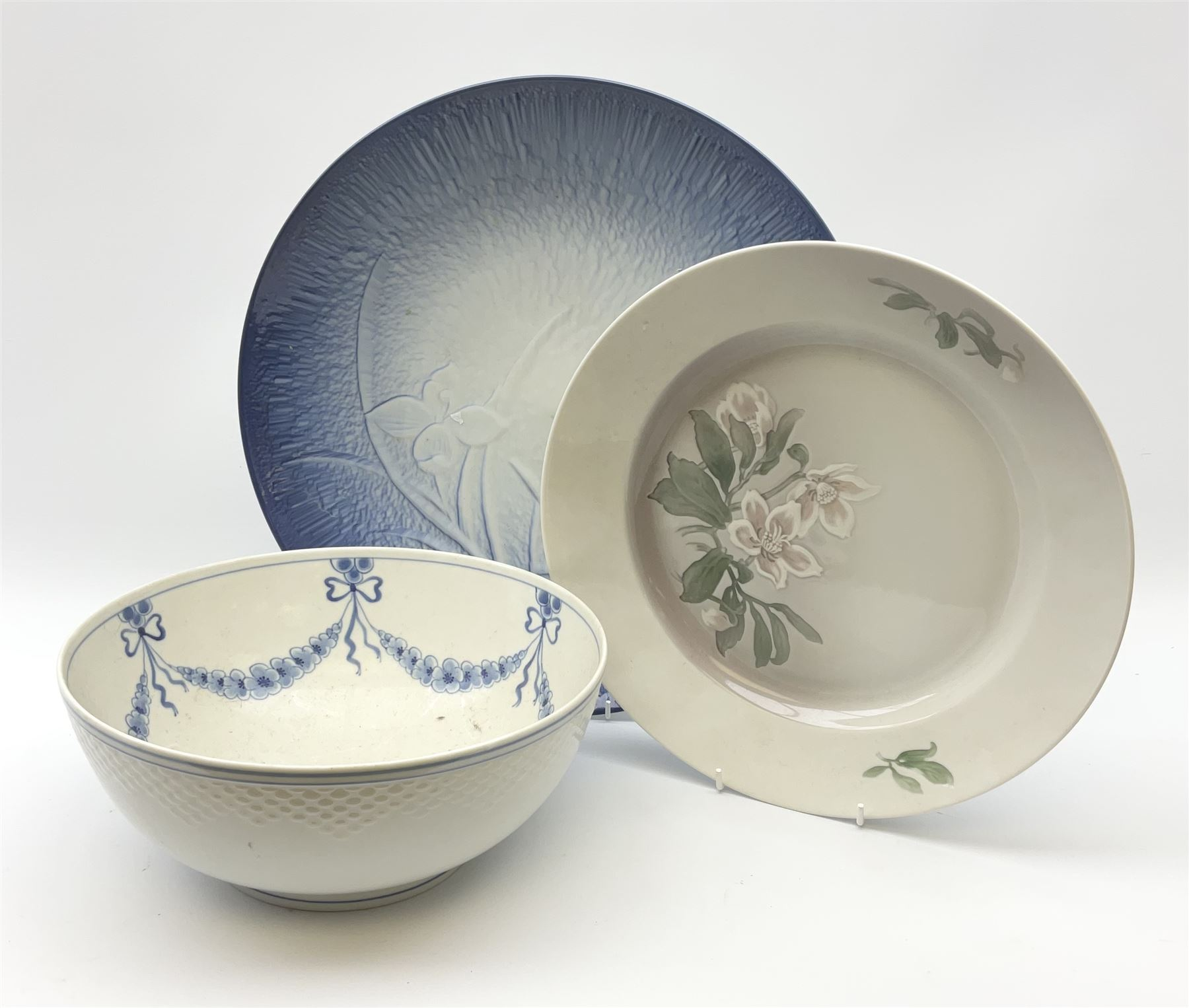 A Bing and Grondahl dish with moulded rim and blue swag decoration to the interior