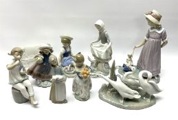 A group of nine Lladro figures