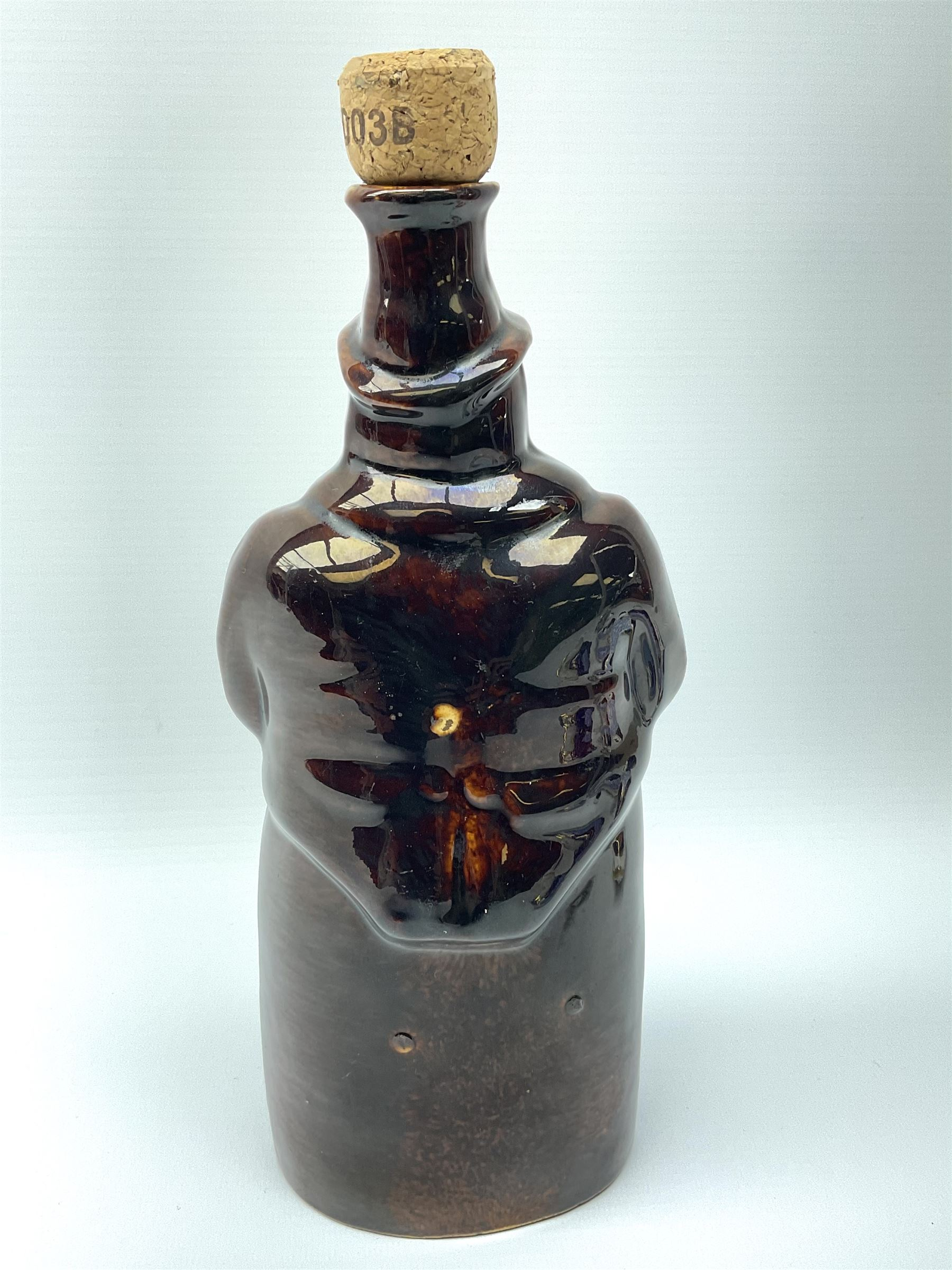 A treacle glazed stoneware bottle modelled as a man seated upon a barrel - Image 6 of 6