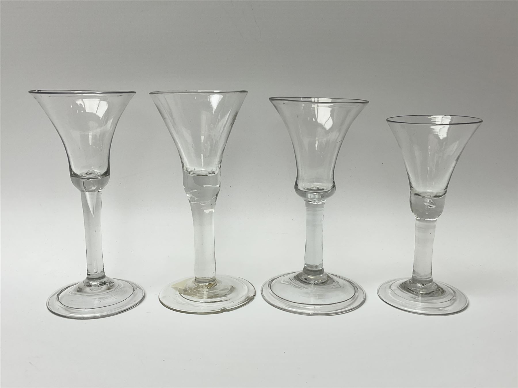 Four 18th century drinking glasses