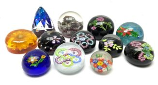 A group of paperweights