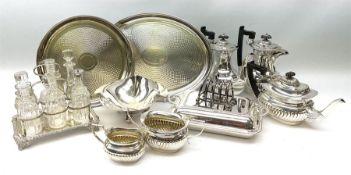 A silver plated six bottle cruet stand