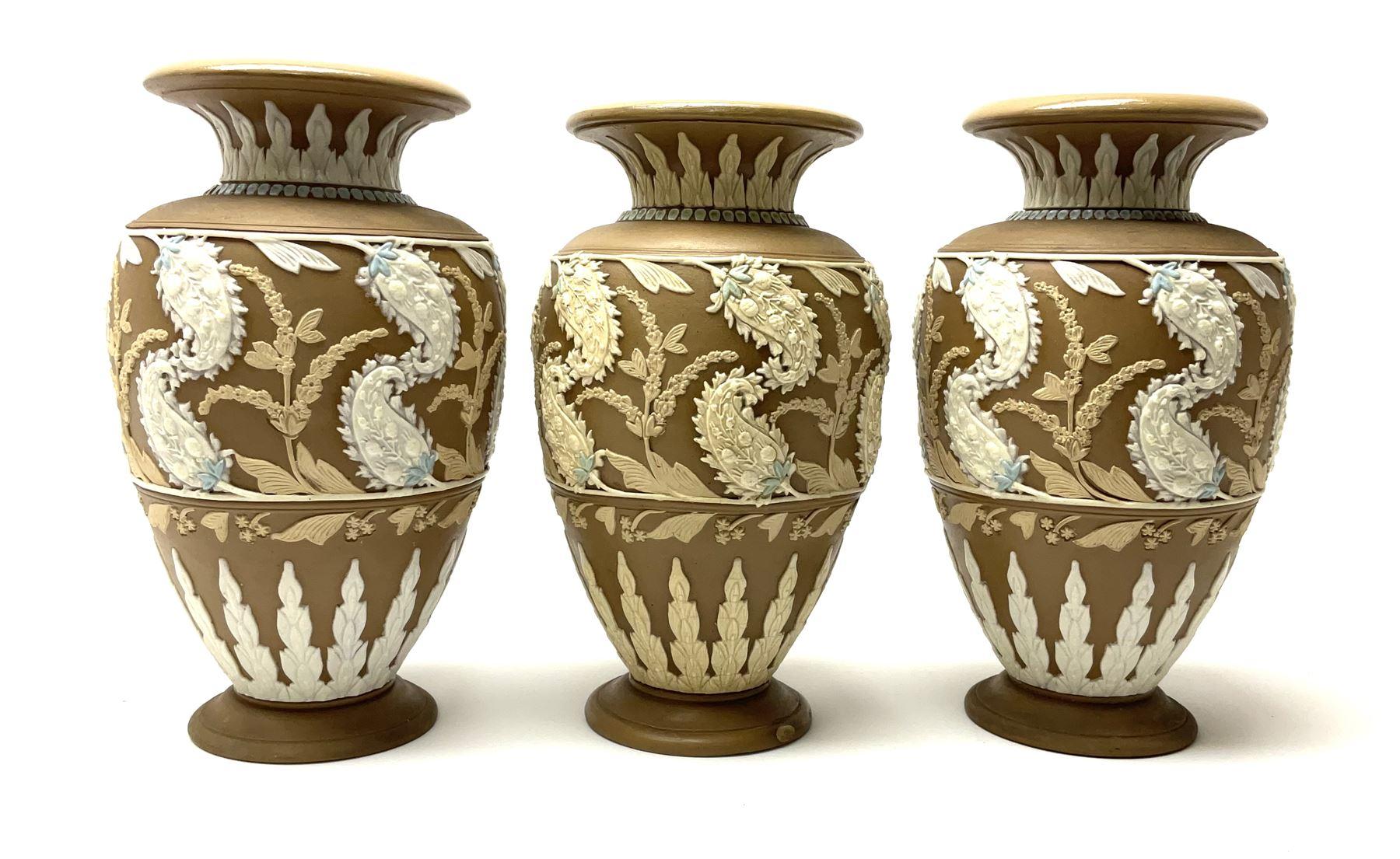 A set of three 19th century Doulton Lambeth silicon ware vases