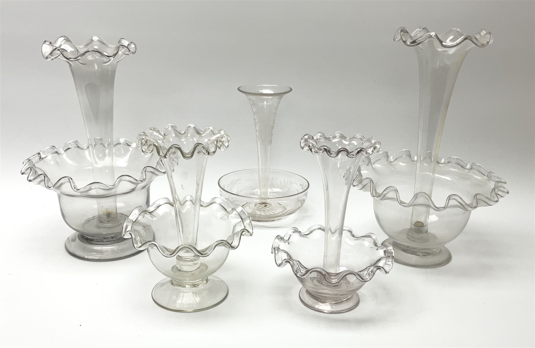 Four Victorian clear glass epergnes