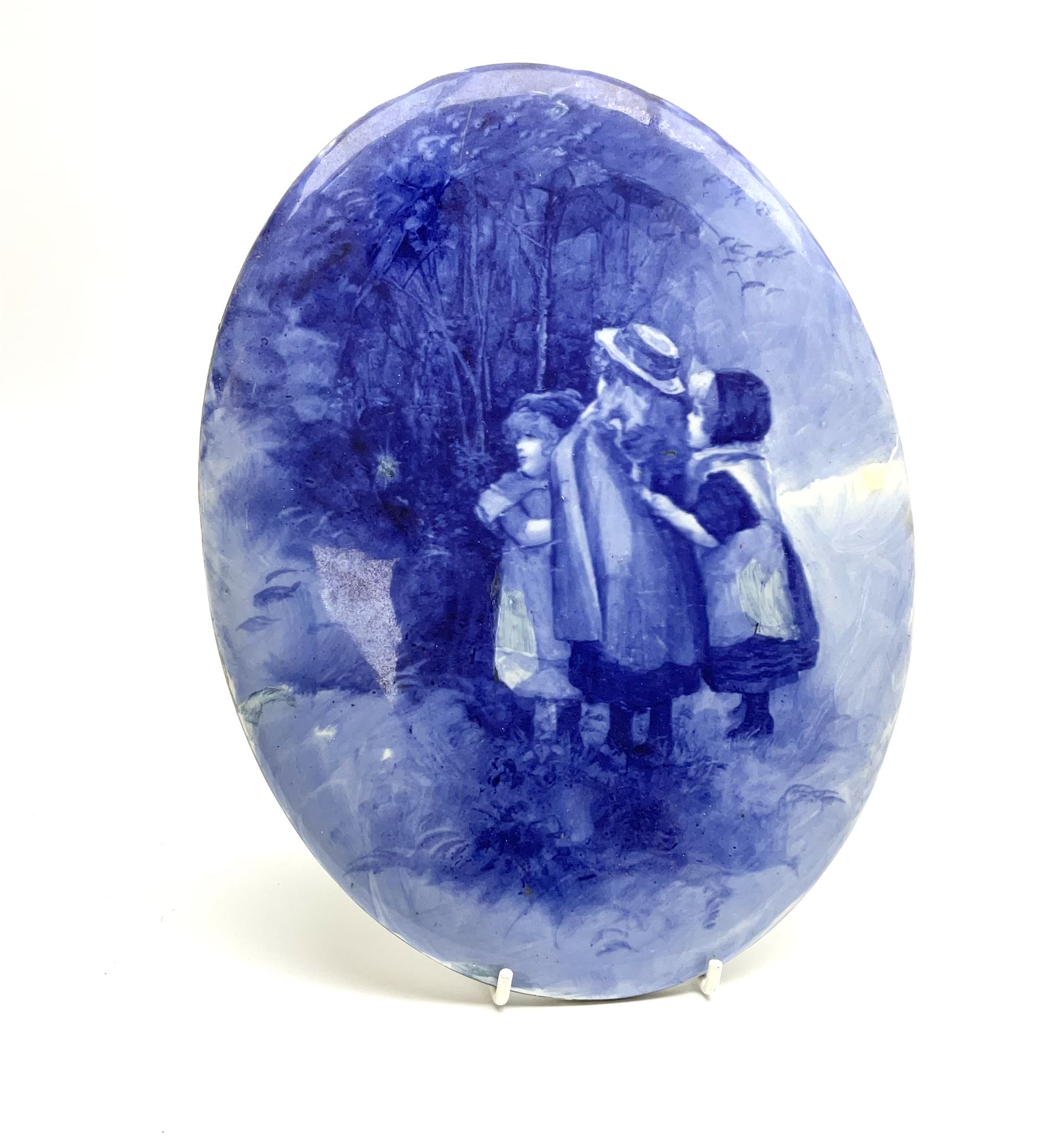 A Royal Doulton blue and white wall plaque