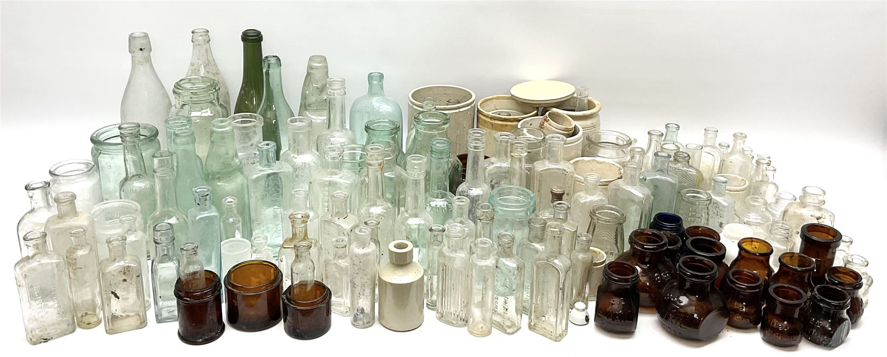 A collection of assorted glass bottles