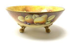 A Coalport bowl hand painted to the interior and exterior with fruit still life upon a mossy ground