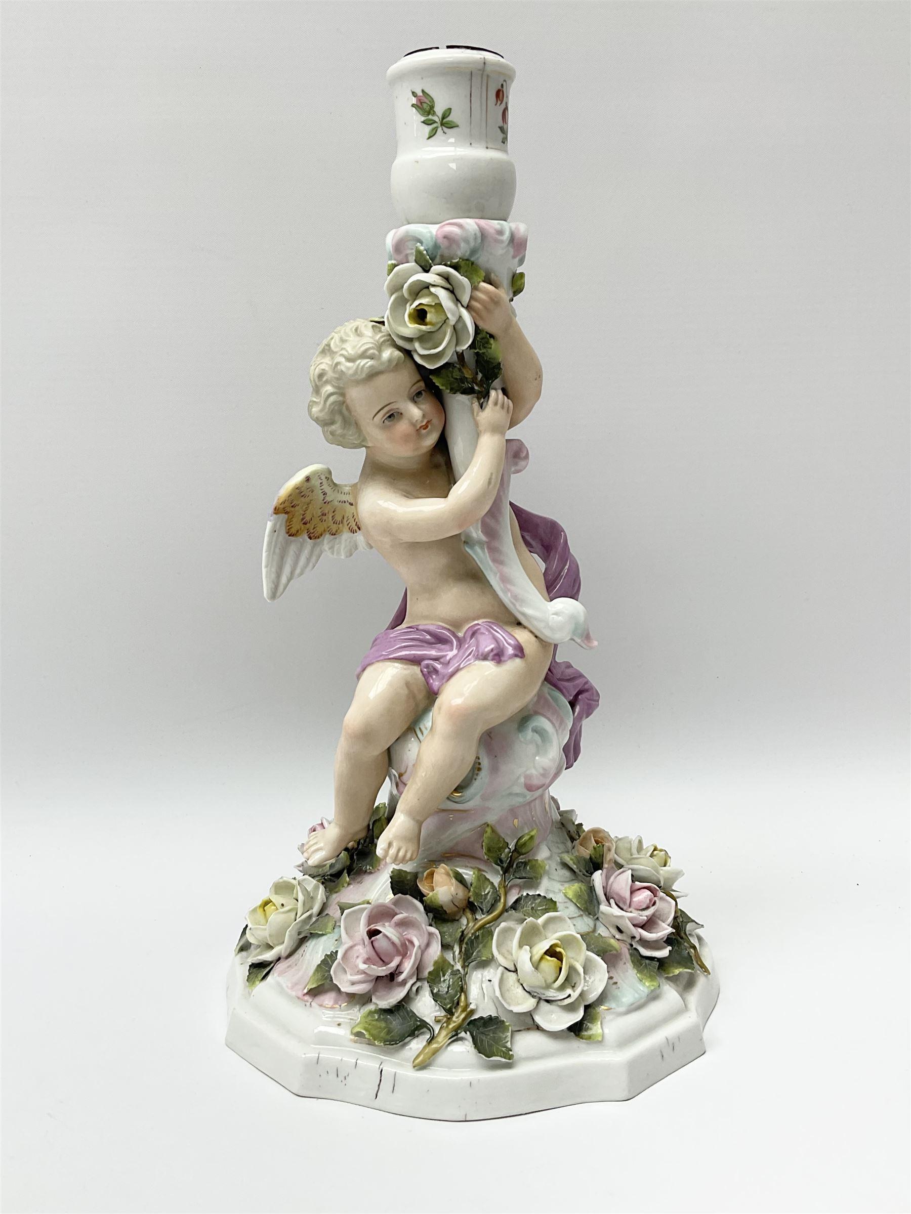 A late 19th century Sitzendorf figural candlestick