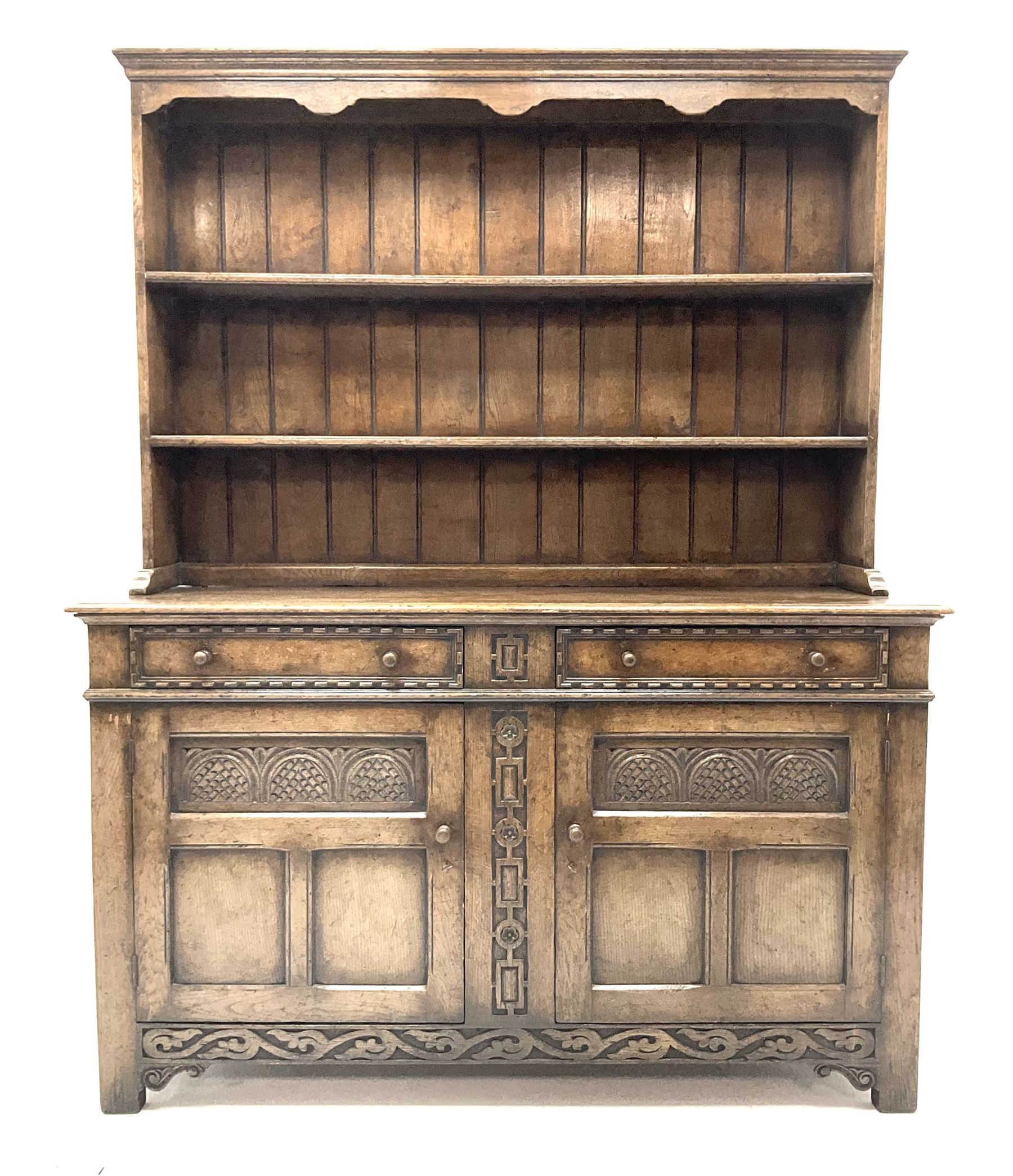 Jacobean style carved oak dresser fitted two drawers and two cupboards