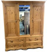 Solid pine triple wardrobe with four drawers