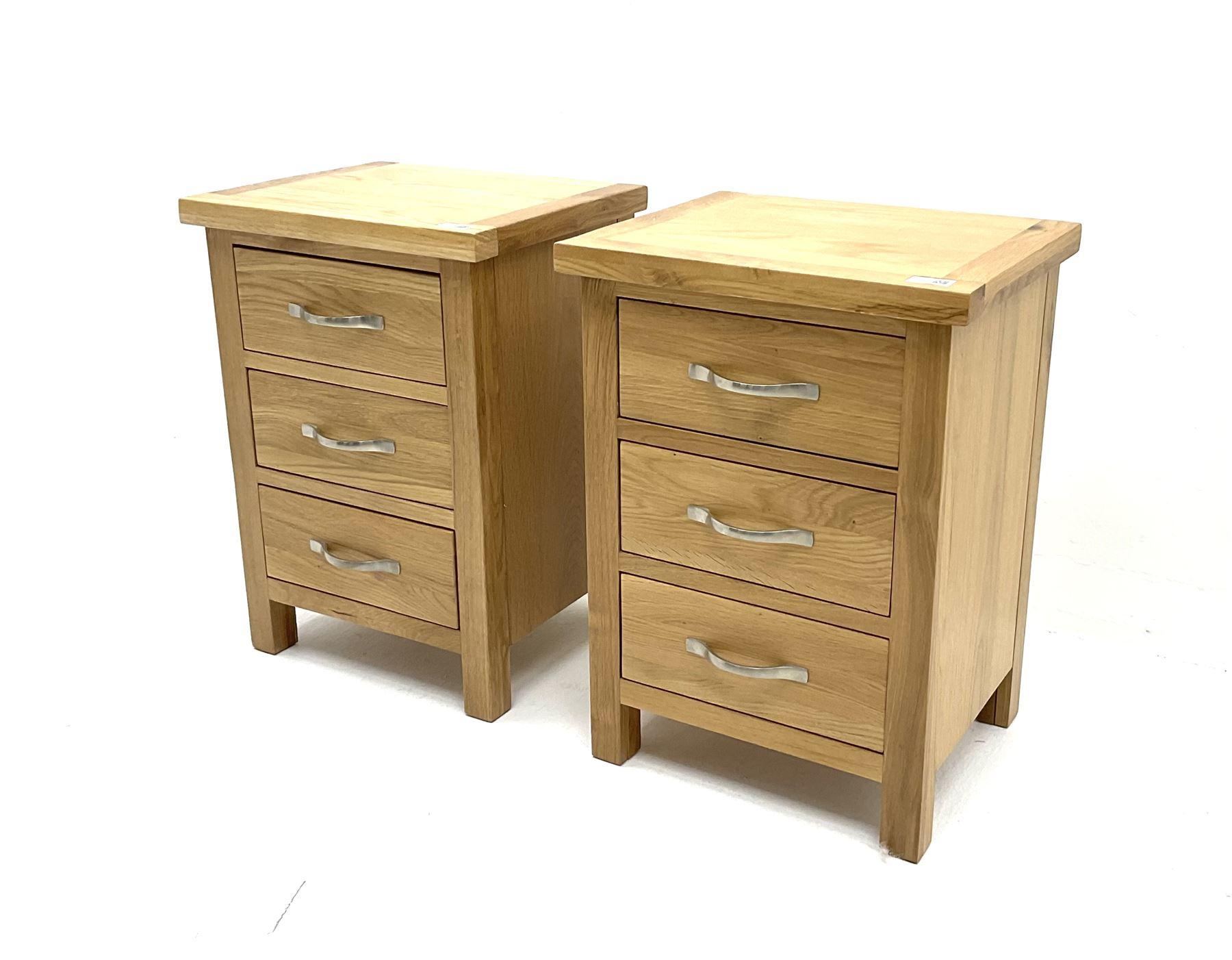 Pair light oak bedside pedestal chests