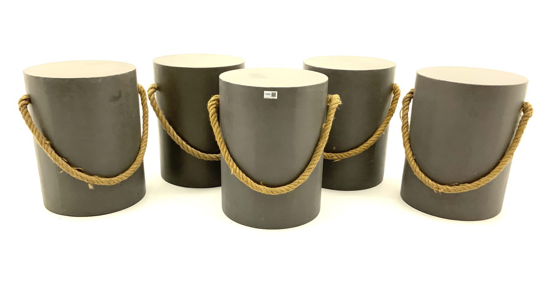 Five painted wood circular stools with rope detail