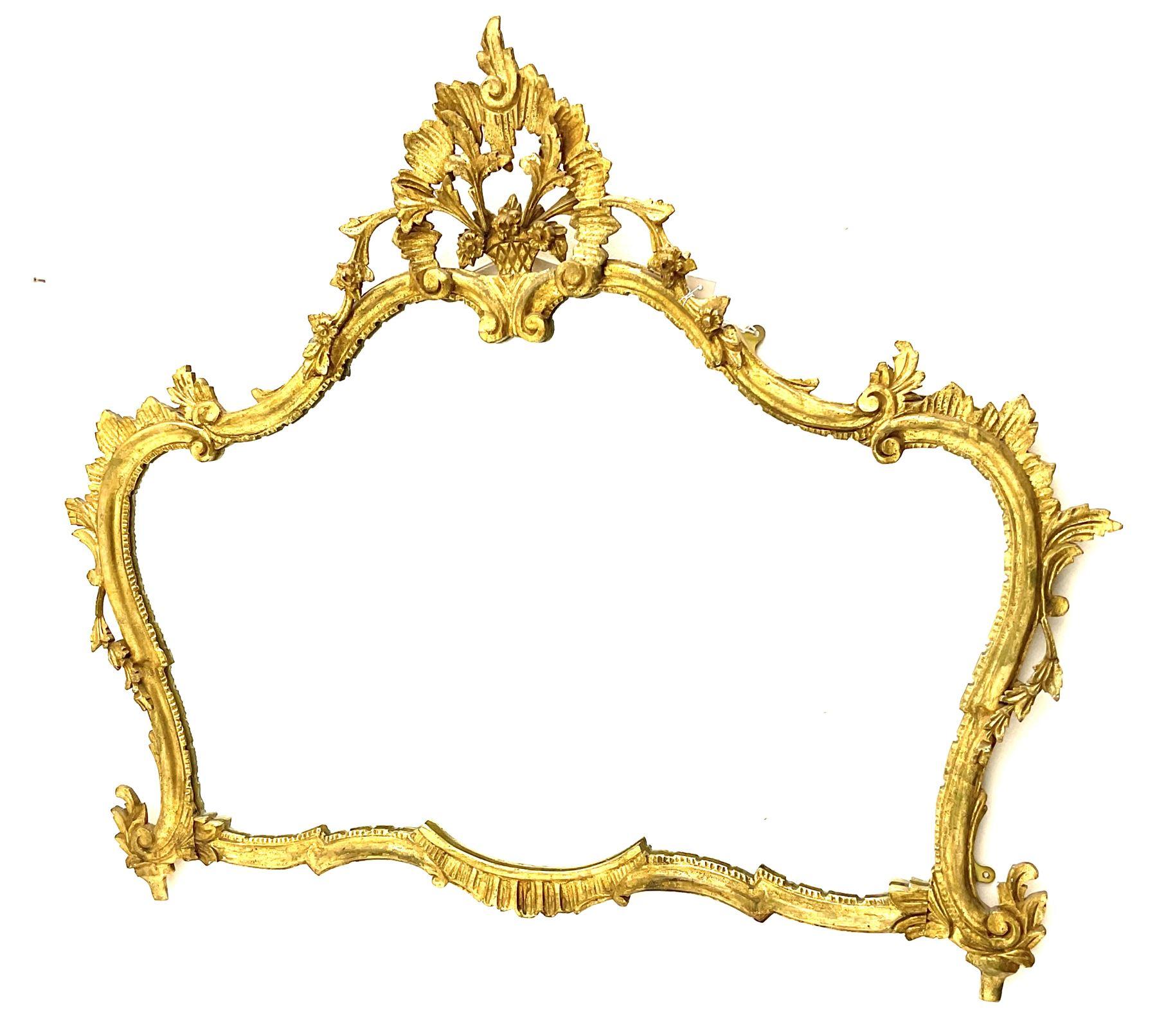 Classical ornate gilt framed shaped wall mirror
